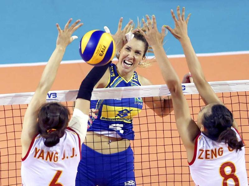 Thaisa Menezes of Brazil spikes against Yang Junjing (L) and Zeng Chunlei (8) of China during their Women's Volleyball World Grand Prix final round in Tokyo. (AP Photo)