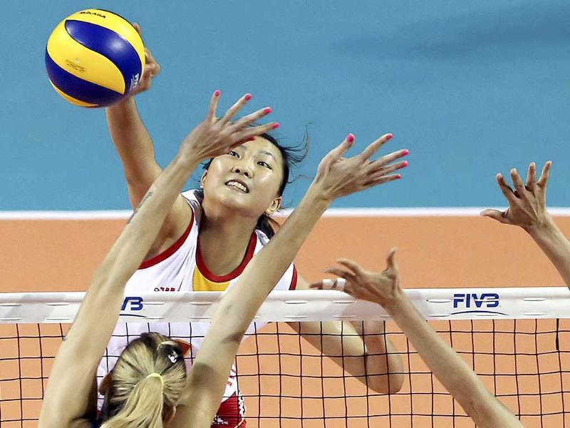 China's Yuan Xinyue spikes the ball against Brazil during the final round of the Women's Volleyball World Grand Prix, in Tokyo. (AP Photo)