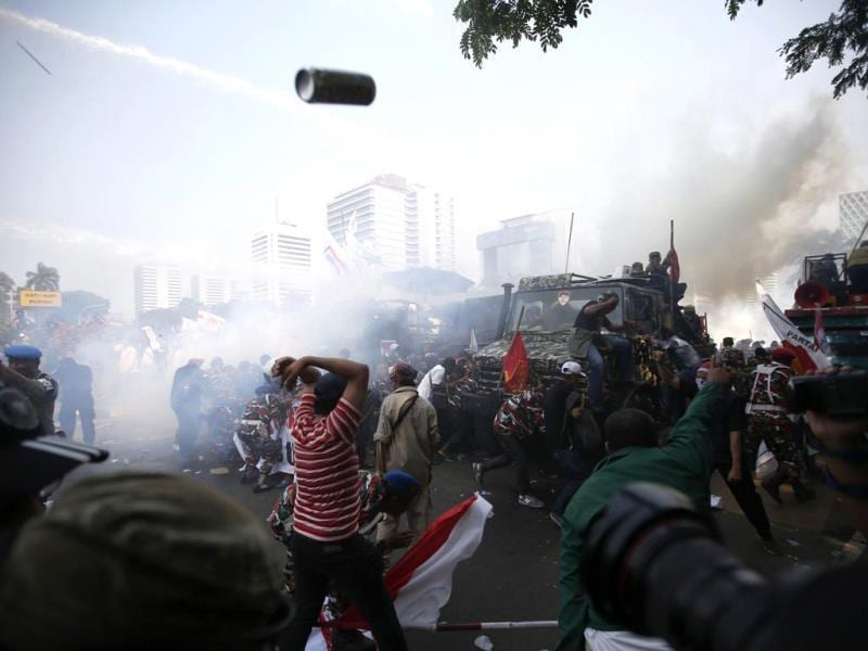 Indonesian police use tear gas and water cannon to disperse supporters of presidential candidate Prabowo Subianto during a protest near the Constitutional Court in Jakarta. (Reuters Photo)