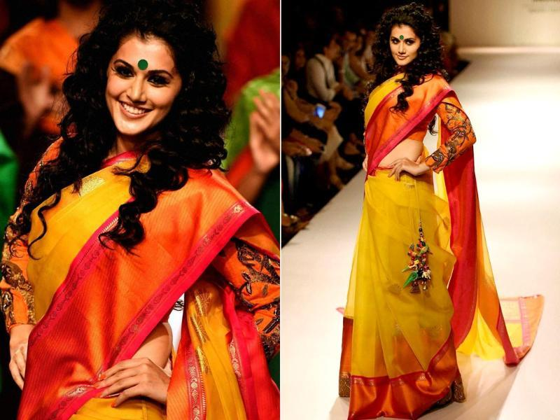 Actor Taapsee Pannu walks the ramp at the Lakme Fashion Week Winter/Festive 2014, in Mumbai on Friday. (PTI)