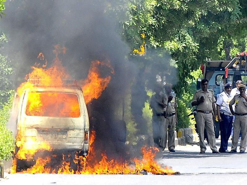 A van catches Fire at Safdarjung Road near Jor Bagh Metro Station no one injured or hurt in the incident, later fire services personnel doused the fire in New Delhi. (HT Photo/Vipin Kumar)