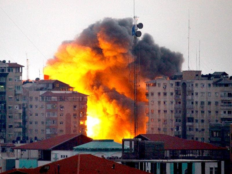 A ball of fire rises from a building following an Israeli air strike in Gaza City. (AFP Photo)