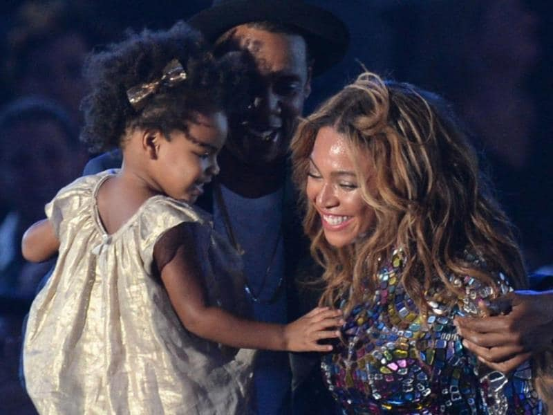2. Seen here with their daughter Blue Ivy, pop star Beyonce and rapper husband Jay-Z put an end to all rumours of their split as they kissed on stage in front of the audience. The father-daughter duo were here to present Beyonce with the Michael Jackson Video Vanguard Award.