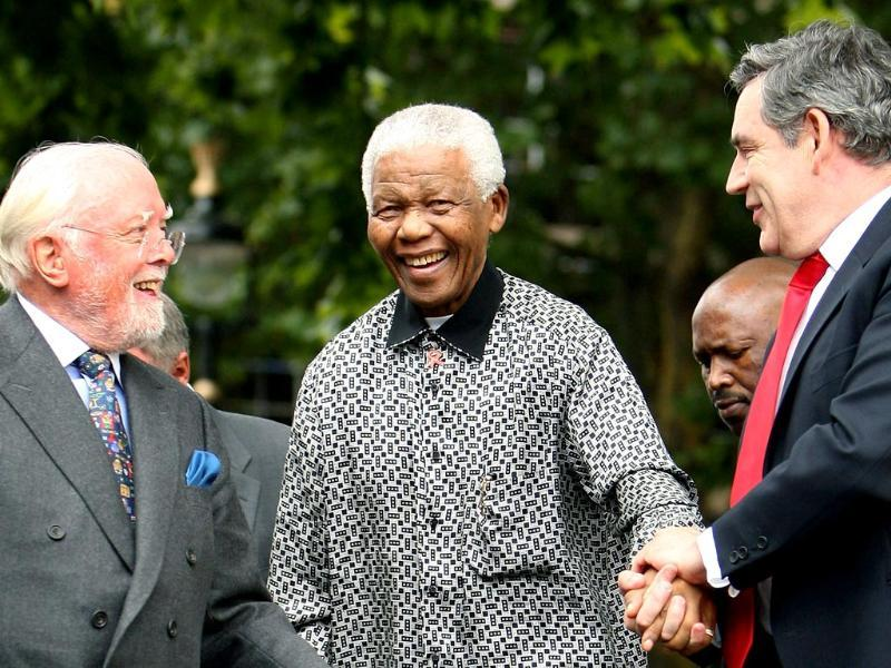 Britain's then Prime Minister Gordon Brown (R) and director Richard Attenborough assist South Africa's former President Nelson Mandela (C) to the podium, during the unveiling ceremony of a statue in Mandela's honour in London's Parliament Square in this 2007 photo. (AP)