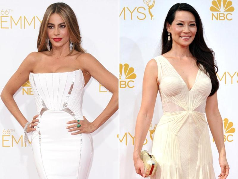 Paint me white: Modern Family actor Sofia Vergara and Charlie's Angels star Lucy Liu look classy in their white and off white gowns. (Reuters)