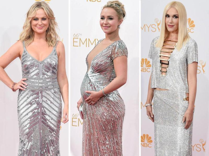 All that bling: Amy Poehler in Theia, pregnant Heroes actor Hayden Panettiere in Lorena Sarbu and singer Gwen Stefani pose on Emmys 2014 red carpet. (AFP)