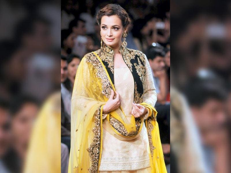 Dia Mirza took the center stage and walked the ramp for designer Vikram Phadnis wearing a bright traditional outfit.