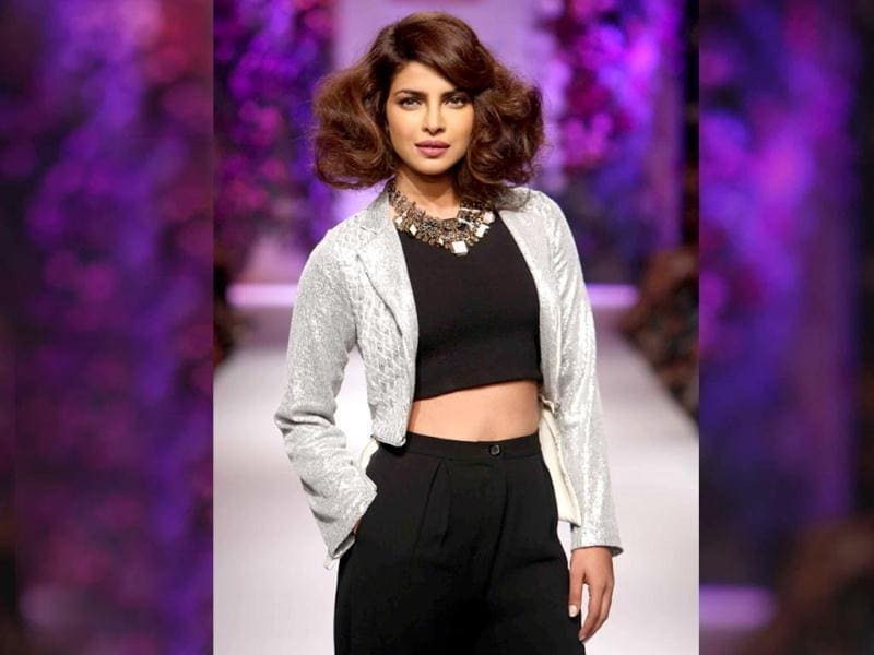 Priyanka Chopra walked the ramp for ace designer Varun Bahl at Lakme Fashion Week Winter/Festive 2014. Dressed in a black crop top, black pants and silver jacket the Exotic singer looked stunning. But what we loved most was her Marilyn Monroe hair style! Go girl!  Bollywood divas reigned supreme at the recently concluded fashion week in Mumbai. The gala boasted of a bevy of actors taking to the runway, we take a look. (Photos: IANS and PTI)