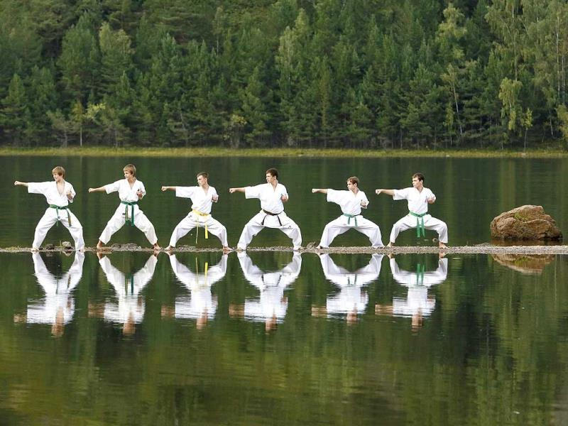 Young members of a local Kyokushin Karate federation perform during an exercise session at a summer training camp in Taiga district on a bank of the Yenisei River near the town of Divnogorsk, outside Krasnoyarsk in Siberia. (Reuters Photo)