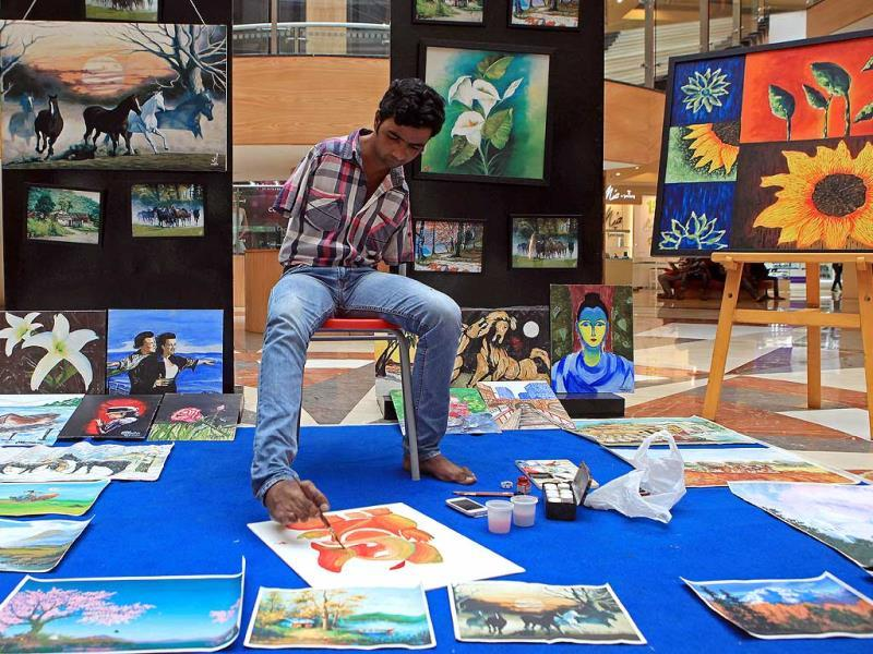 Nadeem Shaikh, a foot painter, paints Ganesha in Inorbit Mall at Malad in Mumbai. (Pratham Gokhale/HT Photo)