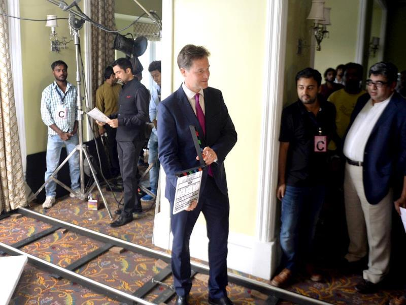 British Deputy Prime Minister Nick Clegg (C) holds the clapperboard at the muhurat shot of Veda in Mumbai on August 26, 2014. (AFP Photo)