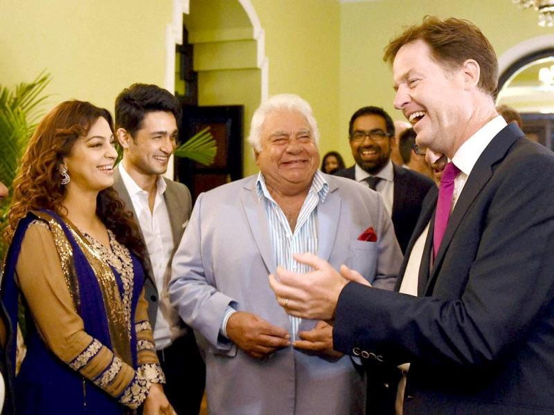 Britain's Deputy PM, Nick Clegg poses with former Indian cricketer Farokh Engineer and Bollywood actor Juhi Chawla at Taj Mahal Hotel (Mumbai). Clegg attended the muhurat shot of Juhi Chawla's film directed by Onir - Veda. (PTI Photo)