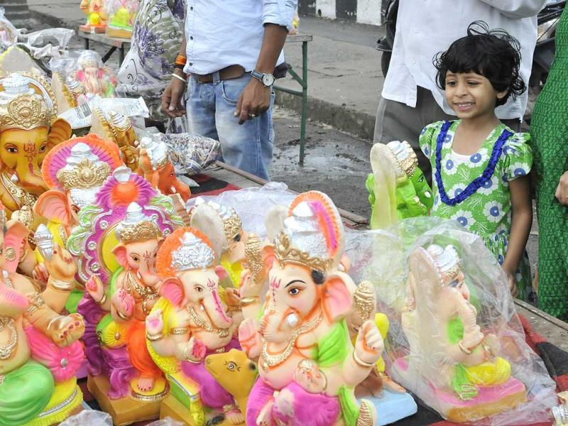 A girl looks at Ganesh idols put up for sale in Bhopal ahead of Ganesh Chaturthi, on Thursday. (Gagan Nayar/HT photo)