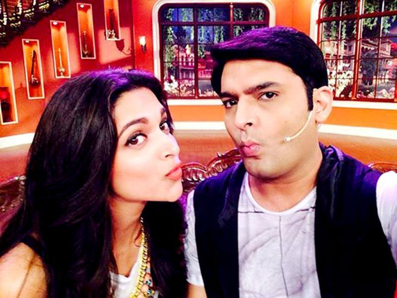 Kapil Sharma poses with Deepika Padukone on the sets of his show Comedy Nights.