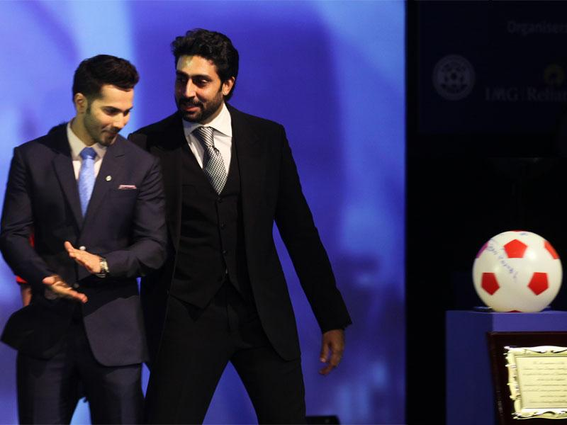 Bollywood actors and co-owners of football clubs, Abhishek Bachhan (R) and Varun Dhawan speak during the emblem-unveiling ceremony of Indian Super League at hotel Trident in Mumbai on August 28, 2014. (Hindustan Times/Vijayanand gupta)