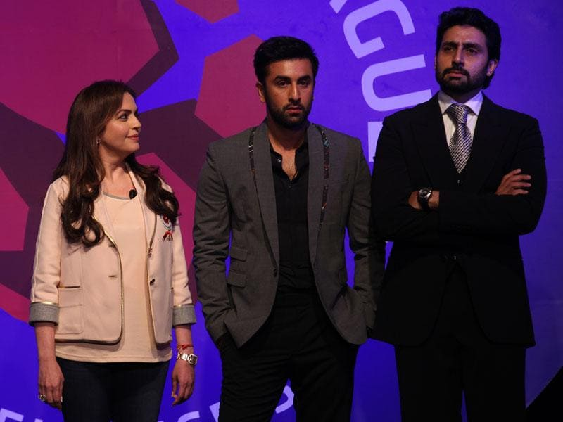 Bollywood actors and co-owners of football clubs, Abhishek Bachhan (R) and Ranbir Kapoor (2nd R), and Nita Ambani, businesswoman and promoter of the Indian Super League, react as Sachin Tendulkar speaks during the emblem-unveiling ceremony of Indian Super League in Mumbai. (Hindustan Times/Vijayanand gupta)