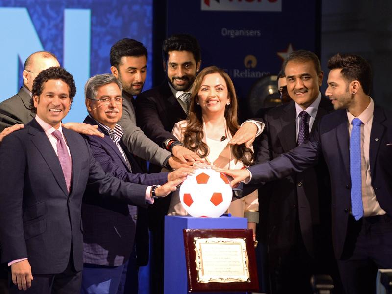 Nita Ambani, director of Reliance Industries, poses with promoters and owners of football teams during the launch of the Indian Super League (ISL) football tournament in Mumbai on August 28, 2014. (AFP/Punit Paranjpe)