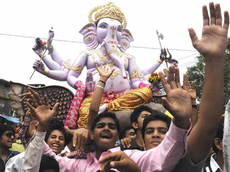 Devotees carry a Ganesh idol for installation on the occasion of Ganesh Chaturthi, in Indore on Friday. (Arun Mondhe/HT photo)