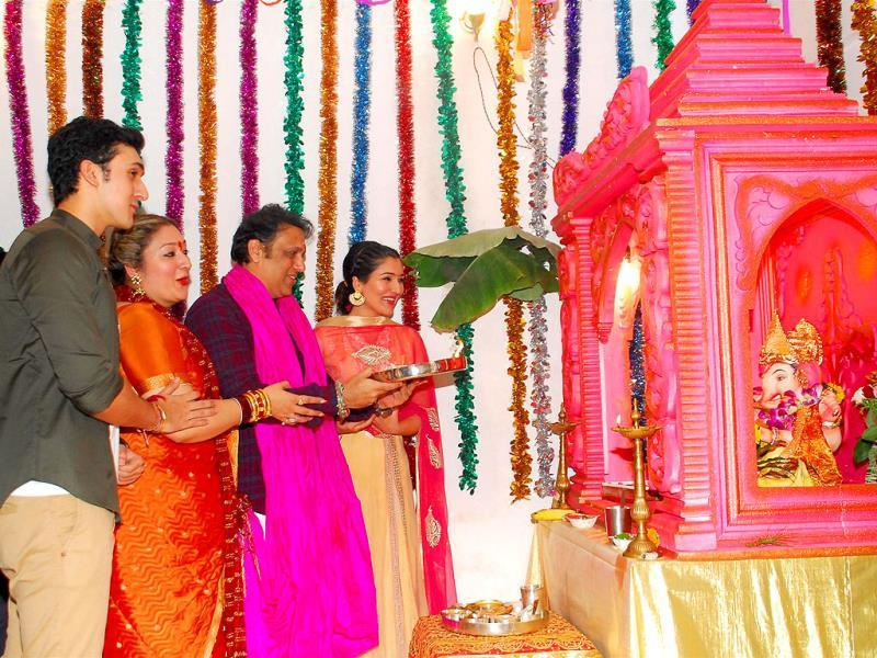 Star of the '90s, Govinda with his wife Sunita and son Yashowardan daughter Narmada during the Ganesh Chaturthi celebrations at his residence in Mumbai on August 29, 2014. (IANS)