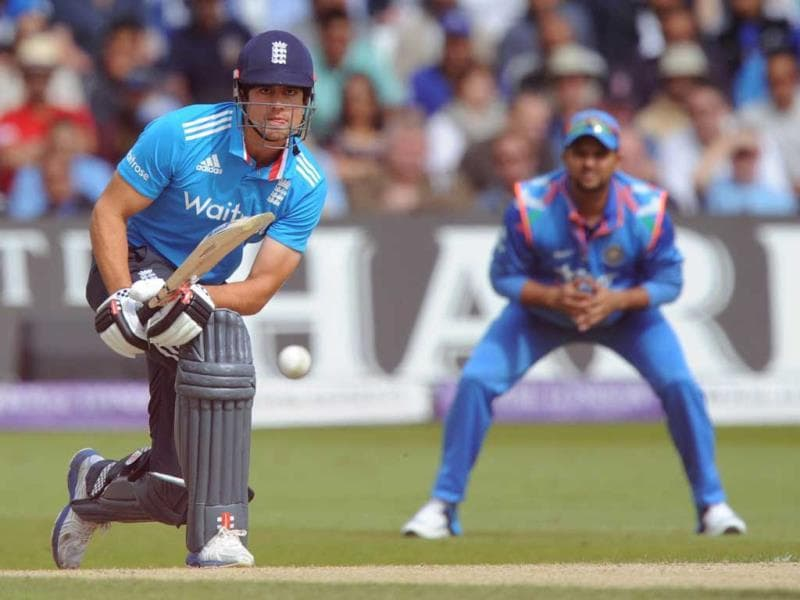 Alastair Cook (L) hits a shot during the third ODI between England and India at Trent Bridge in Nottingham. (AFP Photo)