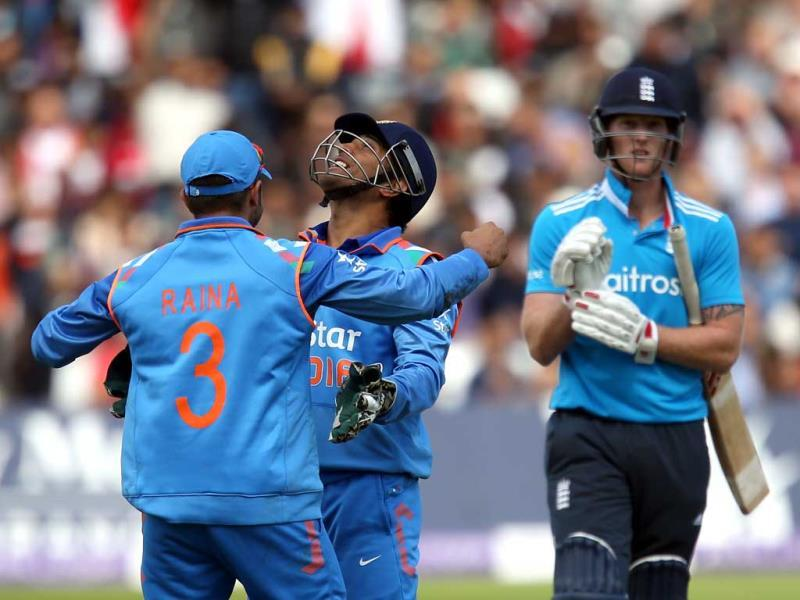 Suresh Raina (L) celebrates the wicket of Ben Stokes with teammate MS Dhoni during the third ODI between England and India at Trent Bridge in Nottingham. (AP Photo)