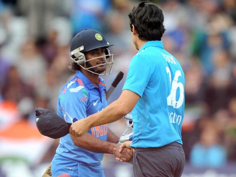 Alastair Cook (R) shakes hands with Ambati Rayudu (L) at the end of the third ODI between England and India at Trent Bridge in Nottingham. (AFP Photo)