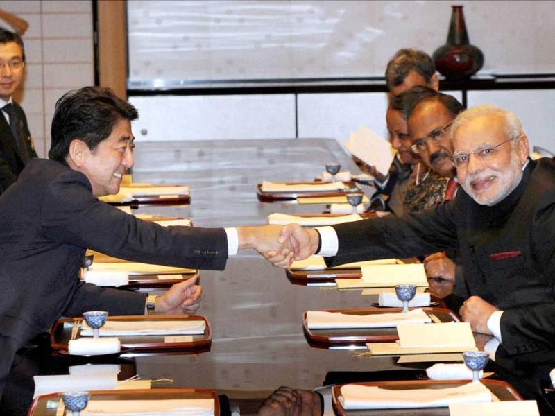 Prime Minister Narendra Modi shakes hands with his Japanese counterpart Shinzo Abe during a private dinner in Kyoto. (PTI Photo)