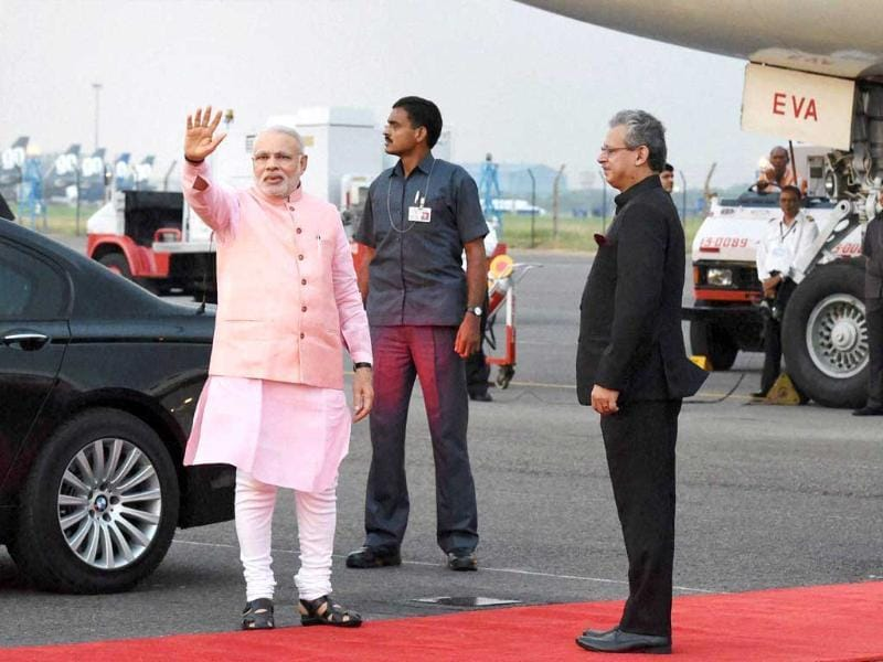 Prime Minister Narendra Modi waves before his departure for the five-day Japan tour, at Palam Airport in New Delhi. (PTI Photo)