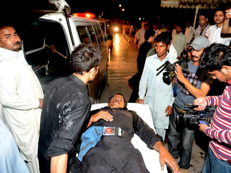 Pakistani paramedics shift an injured frontier constable at a hospital after the clashes in Islamabad on Sunday. (AFP PHOTO)