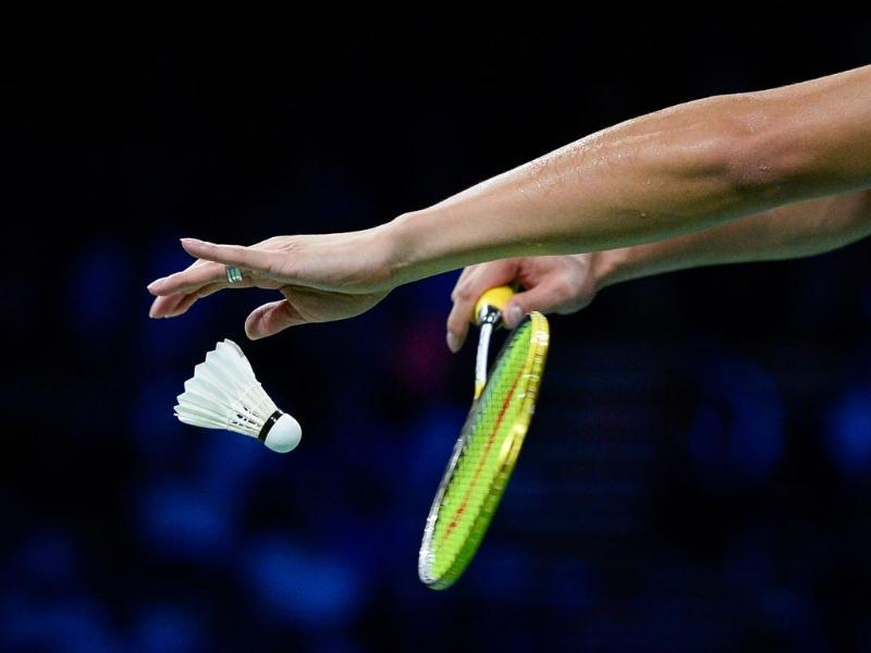 China's Xu Chen serves a ball while competing with China's Ma Jin against Denmark's Joachim Fischer Nielsen and Christinna Pedersen during the mixed double semi final match at the 2014 BWF Badminton World championships, in Copenhagen . (AFP Photo)