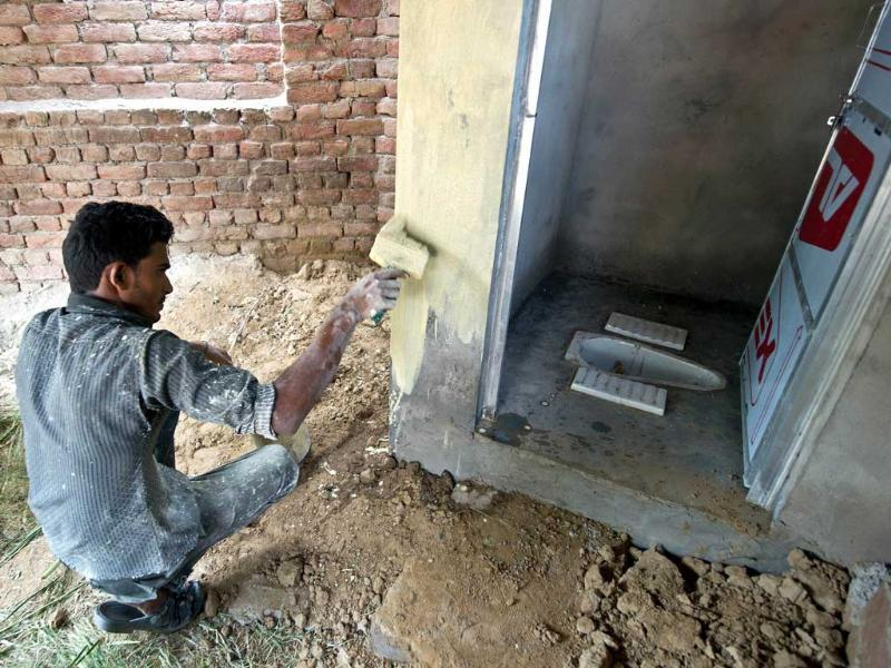 In this photograph a labourer paints a newly-constructed toilet provided by the Sulabh International NGO in the Hirmathala village of Mewat district in the state of Haryana. (AFP Photo)