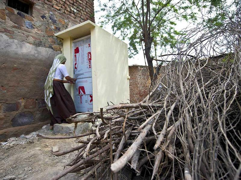 In this photograph village resident Geeta uses a toilet constructed by the Sulabh International NGO in the Hirmathala village of Mewat district in the state of Haryana. (AFP Photo)