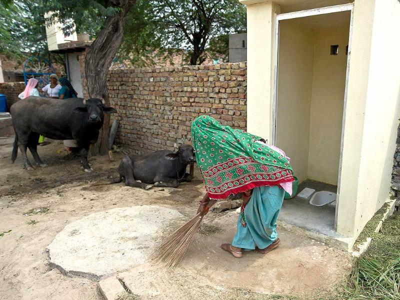 In this photograph village resident Geeta sweeps around newly-constructed toilets provided by the Sulabh International NGO in the Hirmathala village of Mewat district in the state of Haryana. (AFP Photo)