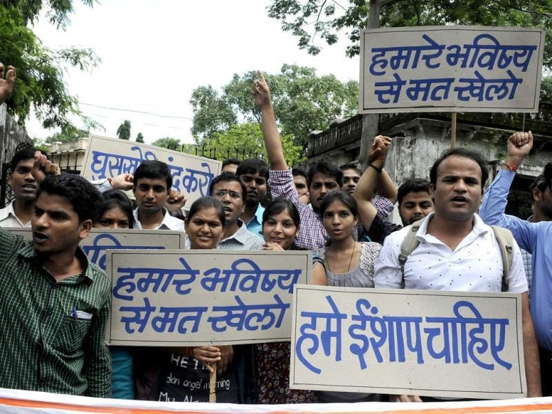 Students stage a demonstration outside MPPSC office for cancellation of 2012 exam, in Indore on Monday. (Arun Mondhe/HT photo)