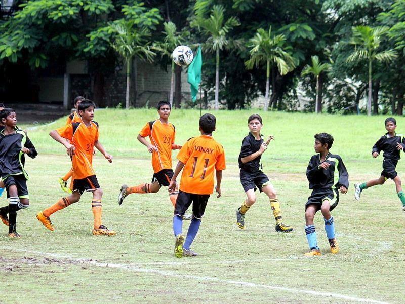 An inter-school football match at Bhawan's Prominent School, in Indore on Monday. (Shankar Mourya/HT photo)