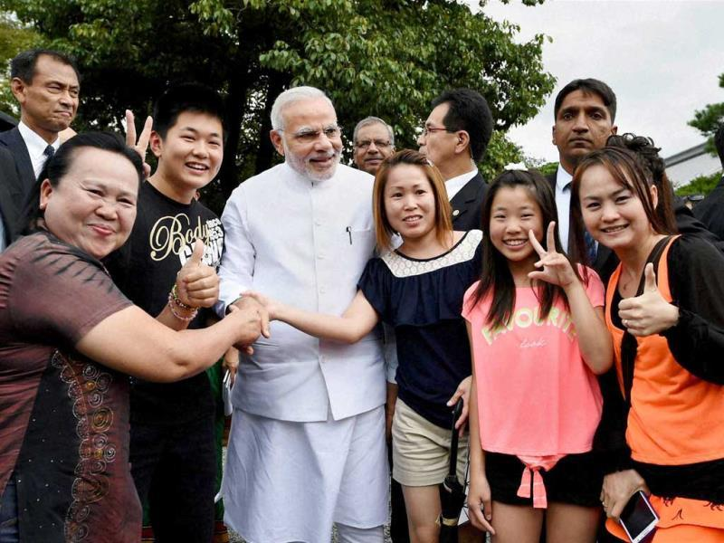 PM Narendra Modi poses for a photo with tourists during his visit at Golden Pavilion, Buddhist temple in Kyoto. (PTI Photo)