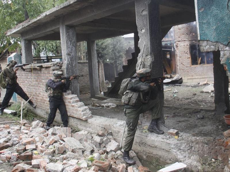 Army soldiers fire towards a house where suspected militants are hiding in Rajpora village south of Srinagar on Tuesday. Waseem Andrabi/HT