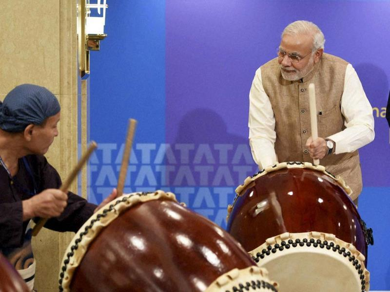 Prime Minister Narendra Modi beats a traditional Taiko drum during inauguration of the Tata Consultancy Services (TCS) Japan Technology and Culture Academy in Tokyo. (PTI Photo)