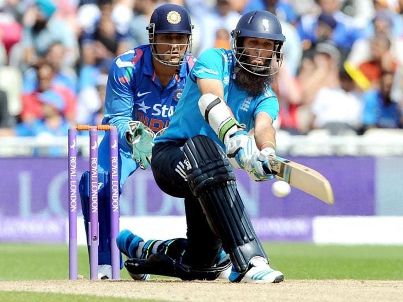 Moeen Ali plays a shot as he is watched by India skipper MS Dhoni during the fourth ODI between England and India at Edgbaston in Birmingham. (AP Photo)