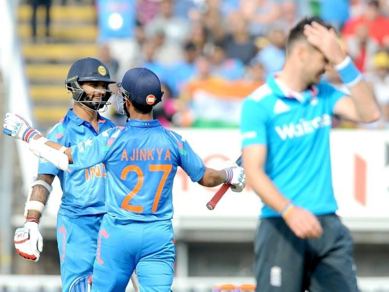 Shikhar Dhawan (L) celebrates with Ajinkya Rahane after scoring his half-century during the fourth ODI between England and India at Edgbaston in Birmingham. (AP Photo)
