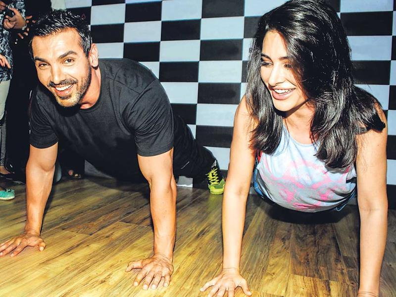 Nargis Fakhri tried to match up with John Abraham in push-ups at an event in Khar, Mumbai. (Photo: Prodip Guha)