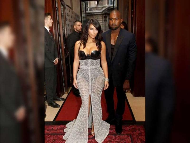 Kim and Kanye West at an award event. Kim donned a Ralph & Russo Couture silver and black gown, which featured a latex body suit and a chainmail style maxi skirt with a large slit down the front. (Kim Kardashian Instagram)