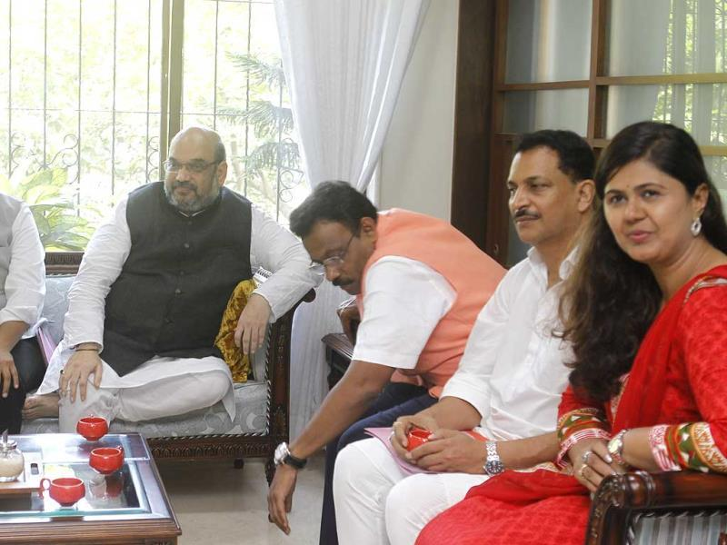 BJP president Amit Shah with the state's party workers at Vinod Tawde's residence in Mumbai. This is his first Mumbai visit after taking charge of the BJP. (Satish Bate/HT photo)