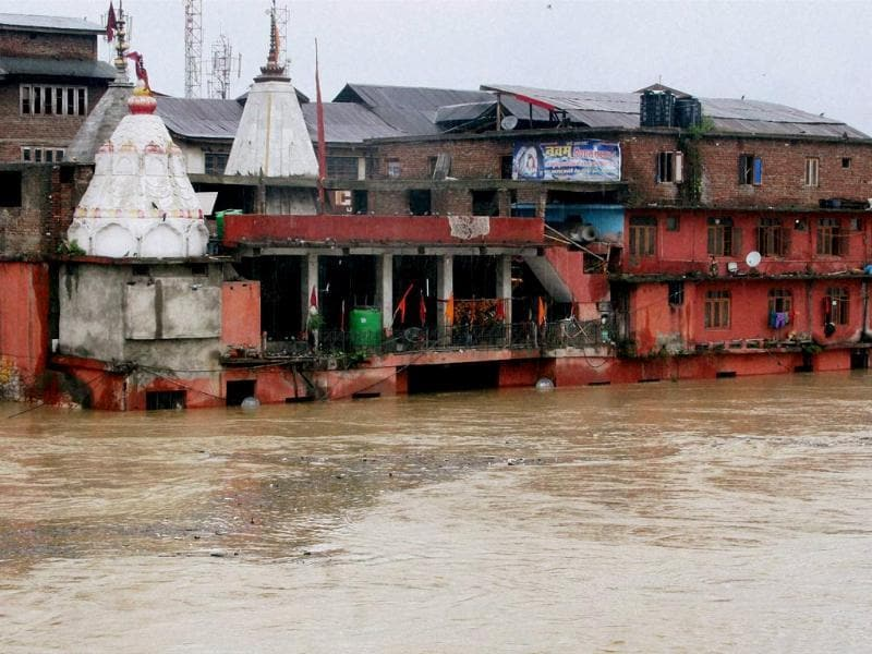 The flood water inundates Hanuman Mandir at Amira after incessant rains in Srinagar. (PTI Photo)