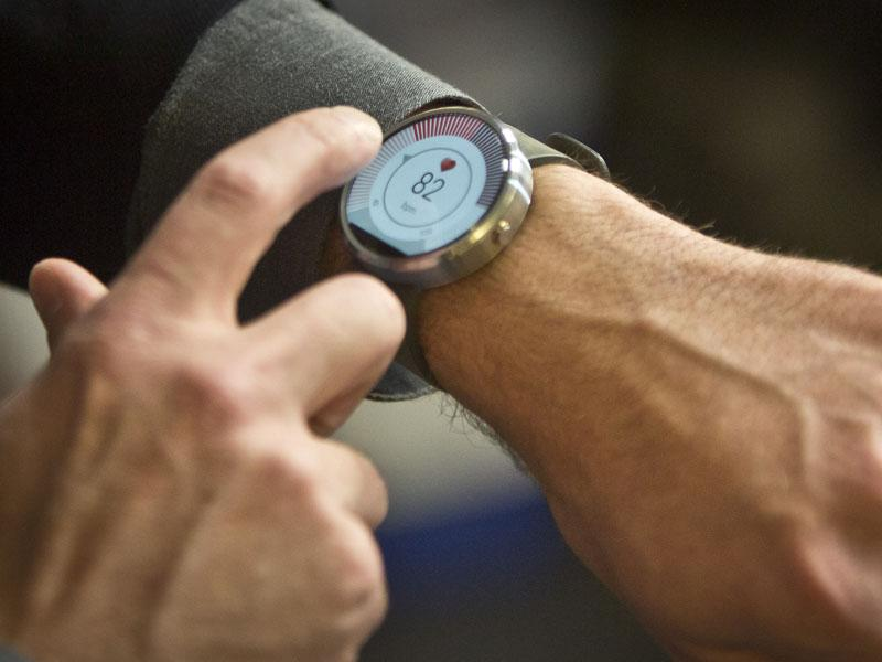The new Moto 360 circular smartwatch is being demonstrated by Steve Sinclair, Motorola's vice president of product management, during an interview on August 27, 2014 in New York. (AP/Bebeto Matthews)