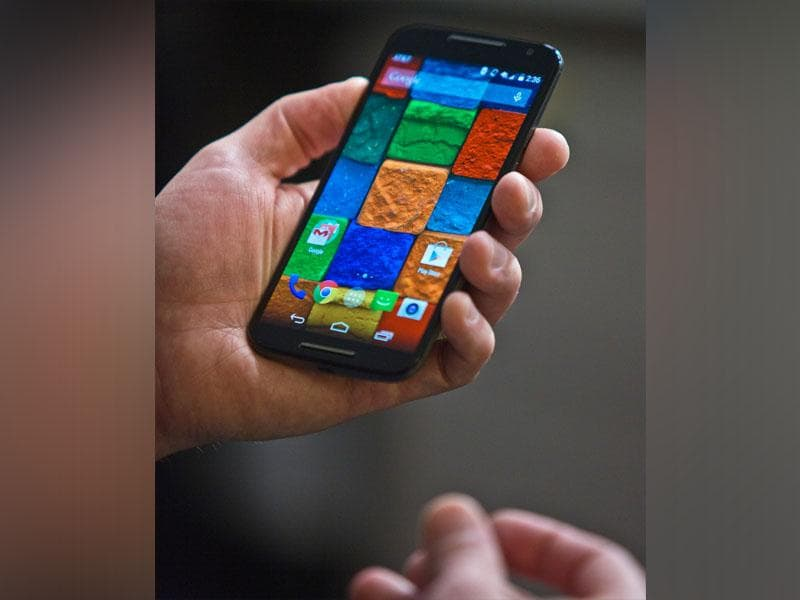 The new Moto X phone that features a 5.1-inch display, 32GB internal storage (non-expandable) and a 12 megapixel rear camera shown by Steve Sinclair, Motorola's vice president of product management during an interview on August 27, 2014. (AP/Bebeto Matthews)