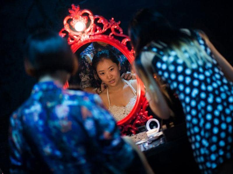 Leng Yuting, 26, applies special make up for her underwater photo shoot at a studio in Shanghai, China, ahead of her wedding next year. (AFP/Johannes Eisele)