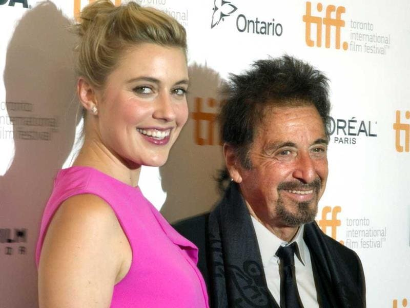 Actor Al Pacino and actor Greta Gerwig pose as they arrive for the premiere of The Humbling at the Toronto International Film Festival in Toronto, September 4, 2014. (Reuters)