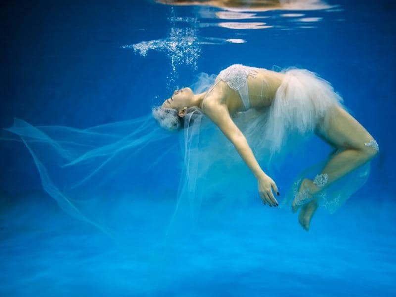 Leng Yuting floats underwater for a solo photo during the pre-wedding shoot in Shanghai. (AFP/Johannes Eisele)