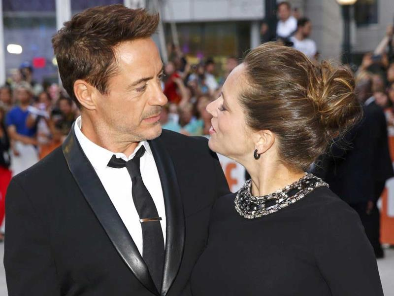 Actor Robert Downey Jr. (left) and his wife, producer Susan Downey pose as they arrive for the gala for the film The Judge at the Toronto International Film Festival in Toronto, September 4, 2014. (Reuters)
